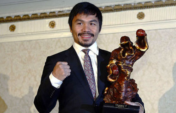 Manny Pacquiao With His Trophy-Michael Howard-Flickr